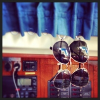 ring fasteners, found in the sewing notions department, made the perfect place to hang sunshades!