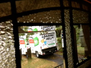 it was a very rainy moving day...  but this tiny truck did the job.