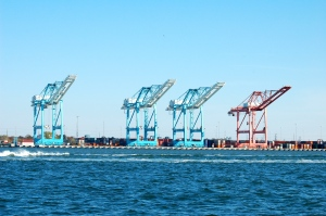 Big old cranes all lined up ready to load the cargo ships.