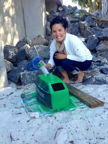 Here's me, at the Lake Worth dinghy dock, painting it green!  If you see a few green rocks there on your next stop, it's my fault :)