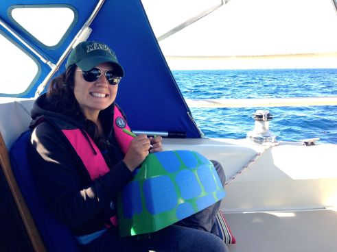 Here's me taping and cutting the painters tape to make the turtle spots.  This is when we were on the ocean.  The project was good to set my mind at ease!  Thanks, Penny, for the awesome knife cutter thing :)