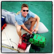 Here's JR strappin' on our dinghy motor. Go Terps!