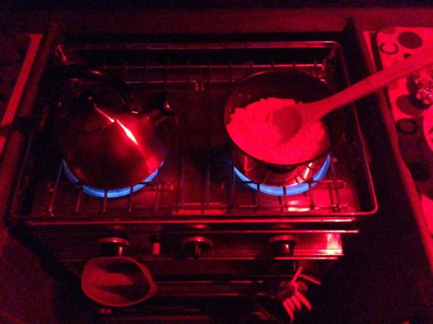 Cooking dinner with our red lights on.  Thanks Peg and David, we love our red lights :)