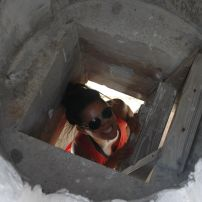 Me climbing up to the top of one of Father Jerome's churches.