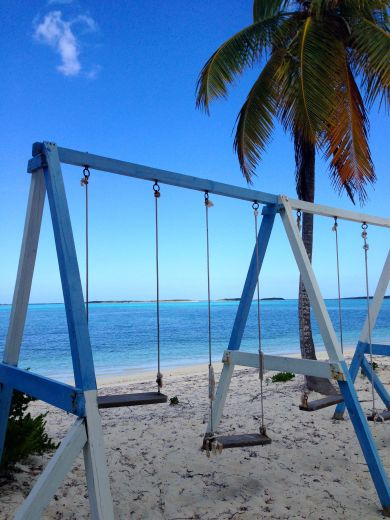 Exuma point restaurant had swings :)
