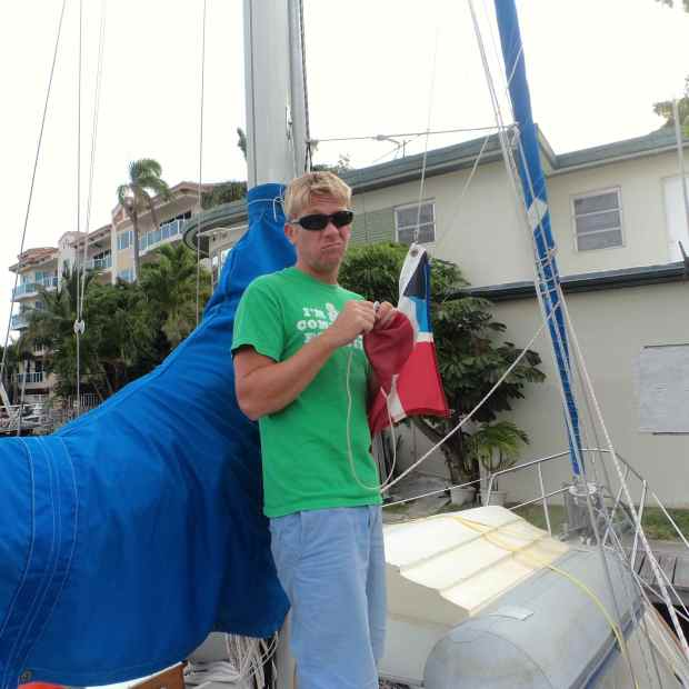 Jake takin' down our Bahamas flag once docked in Ft. Lauderdale.
