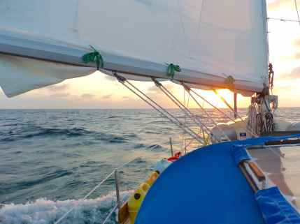 Our reefed mainsail at sunset